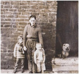 This looks like Victorian Times but that is me and my younger sister with Billy who lived across the back way in about 1967 – we genuinely were a community