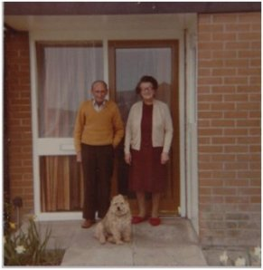 My Grandma and Granddad with Trixie outside their bungalow – my Mam visited them every day until they died